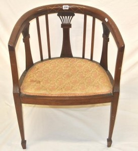 An Edwardian tub armchair (100-150).