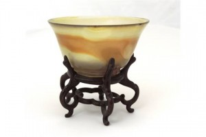 This small bowl on stand sold for 3,000 at hammer over an estimate of 200-300.