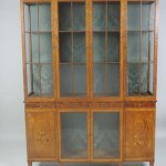 An exhibition quality inlaid satinwood breakfront display cabinet by James Hicks (7,000-10,000)