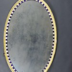 A large Irish George III oval wal mirror with blue and gilt enriched glass studs (3,000-4,000)
