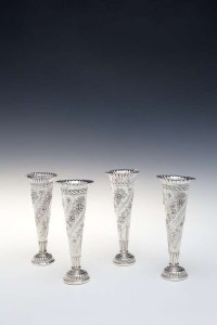 A pair of late Victorian storm vases, mark of William Comyns and two matching examples (150-250).