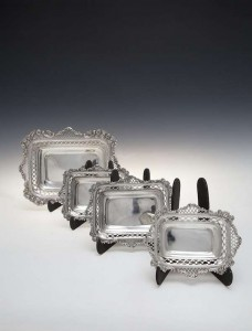 A matched graduated set of four rectangular dishes, London 1895 and 1896, William Comyns, (400-600).