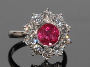 A ruby and diamond cluster ring (4,000-5,000)