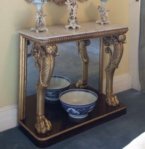 An Irish George III carved gilt wood and rosewood console table (4,000-6,000).
