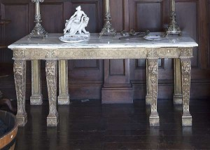 A Palladian revival carved gilt wood side table (5,000-7,000).