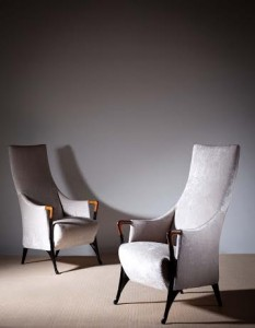 A pair of tall back Progetti open armchairs. (1,400-1,800).