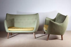 A pair of Poet sofas designed by Finn Juhl