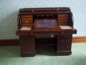 A mahogany cylinder pedestal bureau.