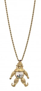 An 18 carat gold and gem-set Clown pendant by Chopard (1,000-1,500).