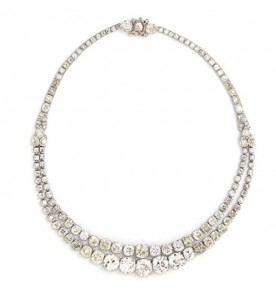 The circa 1930's diamond necklace by Cartier, 47.00 carat total sold for 210,000.