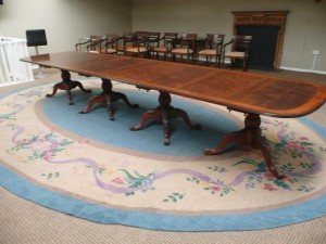 A Dun Emer Guild rug, circa 1950,  made originally for Aghadoe House, Killarney (500-1,000). The reproduction table in the image has a similar estimate.