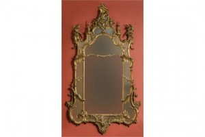 An Irish George III carved gilt wood wall mirror (7,000-9,000).