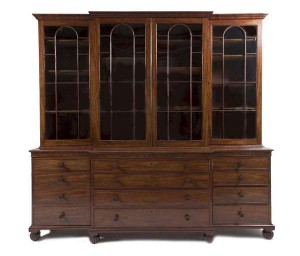 GEORGE IV MAHOGANY BREAKFRONT BOOKCASE by James Winter & Sons (10,000-15,000).