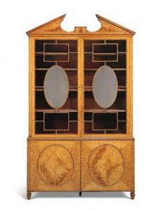 ATTRIBUTED TO THOMAS CHIPPENDALE, CIRCA 1773-75 A GEORGE III SATINWOOD BOOKCASE (£80,000-120,000).