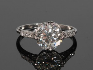 Antique diamond solitaire ring (9,000-10,000).