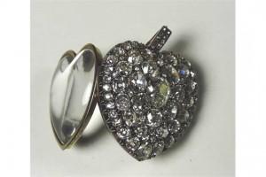 A 19th century heart shaped diamond locket with 63 stones (7,000-9,000).