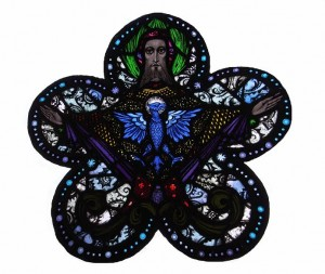 "A cinquefoil stained glass panel by Richard King ""God the Father and Holy Spirit"" from the Harry Clarke Studios, formerly on display at All Hallows College in Dublin (2,000-3,000)."