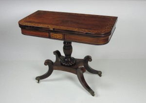 A Regency card table once at Fota House in Cork.