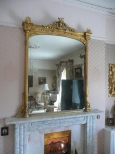 A gilt overmantle mirror.