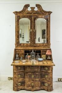 An 18th century bureau secretary bookcase  ($6,000-8,000).