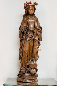 Carved oak statue of St. Catherine ($3,000-5,000).