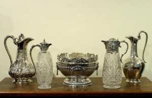 A selection of antique silver mounted claret jugs.