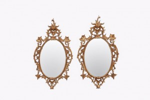 Late 19th century oval carved gilt-wood mirrors. English.