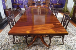 An Irish George III three pillar dining table (40,000-60,000).