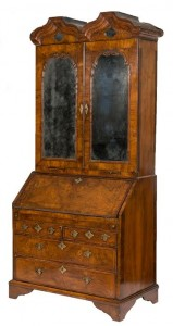 A c 1710 Queen Anne walnut bureau cabinet (9,000-14,000)