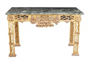 One of a pair of George III Chinese Chippendale carved gilt wood console tables (15,000-25,000)