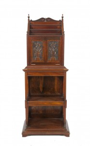 AN ARTS AND CRAFTS WALNUT UPRIGHT SHEET MUSIC CABINET (400-600).