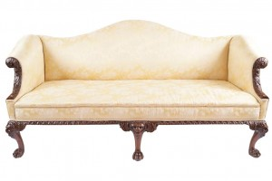 An Irish George II walnut and upholstered settee at Sheppards on December 1.