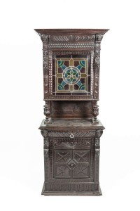 A VICTORIAN JACOBETHAN CARVED AND STAINED OAK UPRIGHT CABINET (300-500)