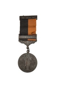 A 1919-21 WAR OF INDEPENDENCE MEDAL, with Comrac Bar, black and tan ribbon and clasp bar (300-500)