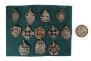 The collection of 12 Gaelic Football medals.