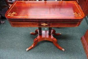 A Regency card table (2,000-3,000)