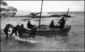 The James Caird being launched from the shore of Elephant Island in April 1916.