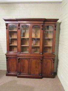 A four door Victorian breakfront bookcase