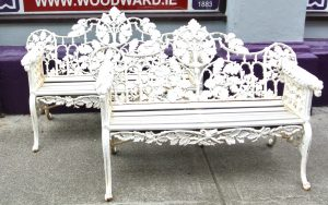 A pair of Coalbrookdale style garden seats.