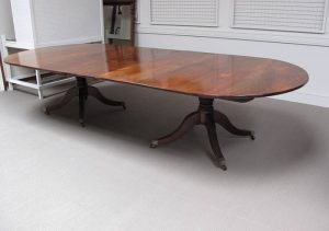 An early q19th century twin pedestal dining table (6,000-8,000)