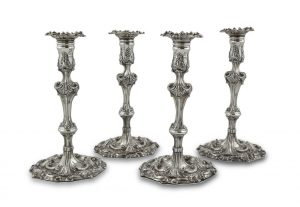 SET OF FOUR IRISH GEORGIAN SILVER TABLE CANDLESTICKS, Dublin c.1760, makers mark of Michael Cormick & William Townsend (12,000-14,000)