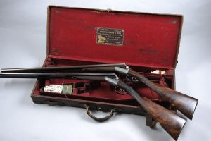 A pair of  12 bore round action ejector guns by Johh Dickson and Sons, 1902 (£10,000-15,000)