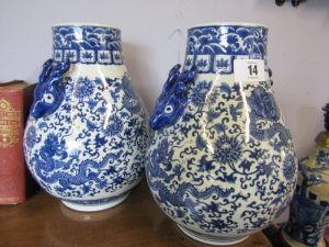 "Pair of blue and white vases, 13"" high (100-150)"