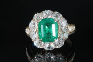A certified Colombian emerald ring in diamond surround (10,000-12,000)