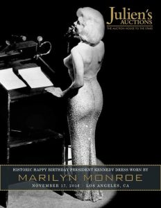 The catalogue cover for the sale show's Marilyn wearing the dress on stage.  Courtesy Julien's Auctions