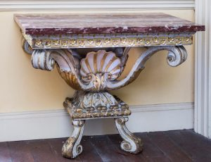 One of a pair of 18th century carved console tables which sold for 145,000 at hammer today.
