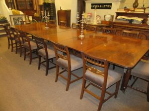 A Cork Regency dining table and a set of Georgian six bar chairs