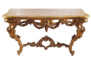 One of a pair of George III period carved gilt console tables (15,000-25,000)