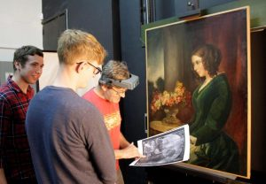 The overpainted portrait by Daniel Maclise of Catherine Dickens being examined at the Hamilton Kerr Institute.