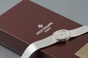 A lady's 18ct white gold, diamond-set watch by Patek Phillipe - it comes from the estate of Costelloe Lodge in Connemara - and is brand new, complete with tags, sleeve and boxes, (3,000 - 5,000).